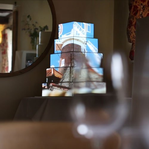 Cley Windmill projection mapped on a wedding cake