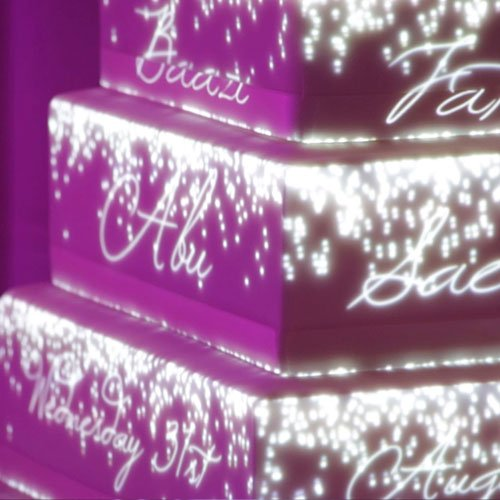 Wedding cake mapping projection personalised with name of the bride and groom